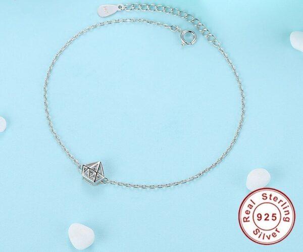 Beau bracelet argent et sa cage en forme de diamant
