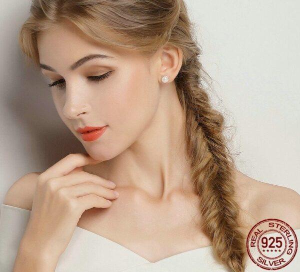 Boucles d'oreilles en argent et leur demi perle blanche