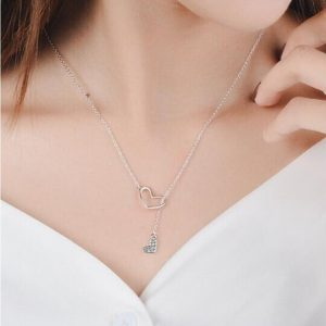 collier petit coeur traversant un grand coeur